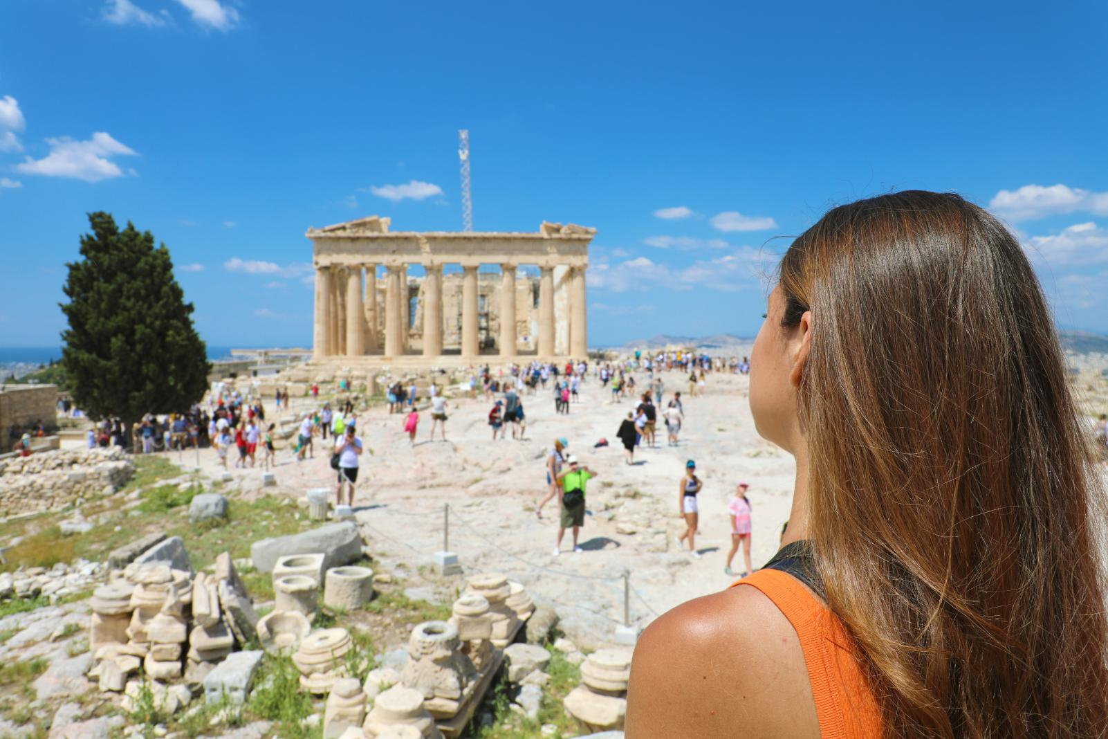 woman infront of Parthenon Athens