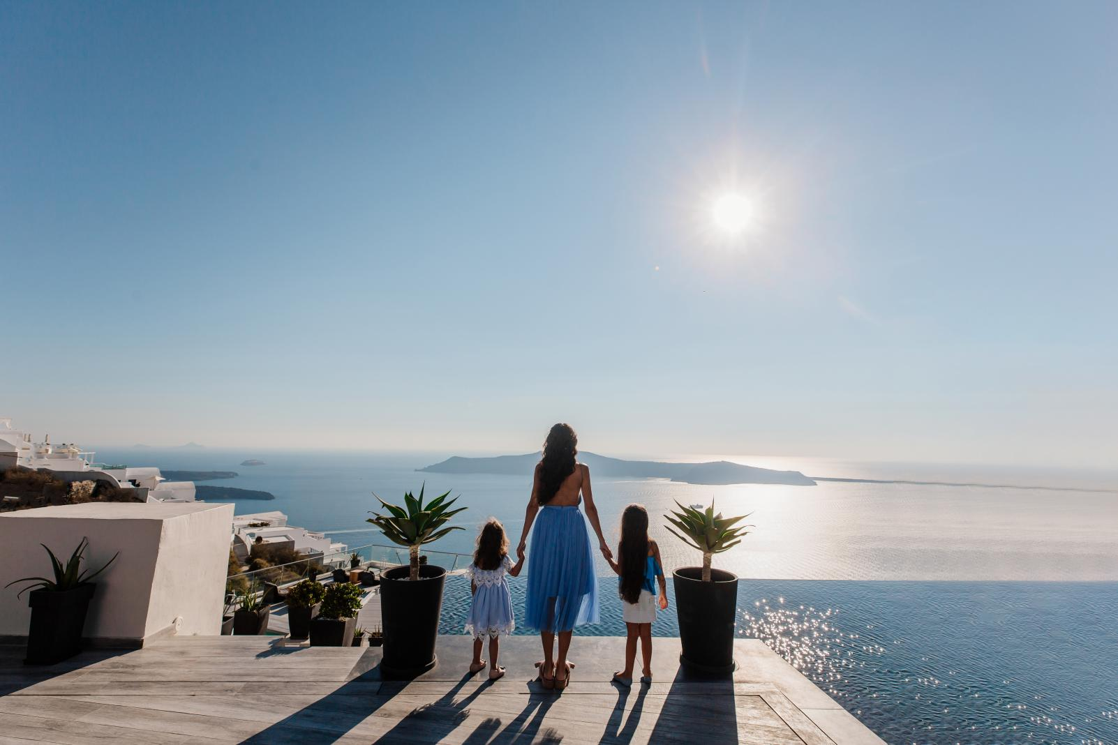 Mom and kids enjoying the caldera view in Santorini KidsLoveGreece.com