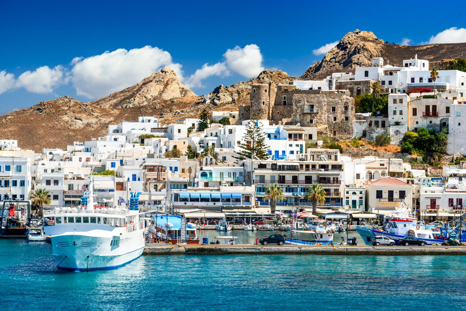 Naxos port with boat and white houses