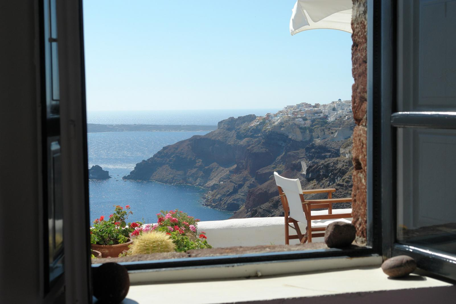 Santorini caldera view through room window KidsLoveGreece